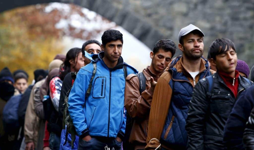 "alt=""migranti"""